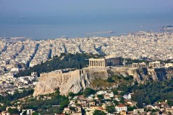 A view of Athens. The Acropolis in the foreground and in the distance the sea.