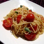 Cooking In Plain Greek, spaghetti with cherry tomatoes and garlic.